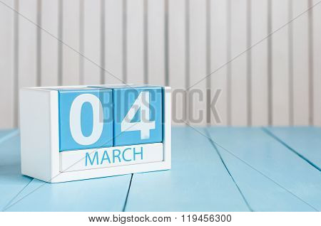 March 4th. Image of march 4 wooden color calendar on white background.  Spring day, empty space for