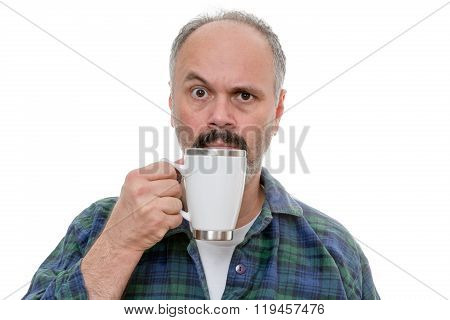 Man With Glass Near Face And Puzzled Expression