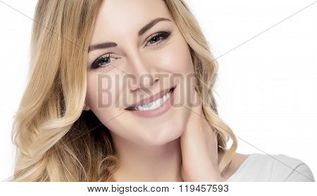 Beautiful smiling blonde woman  isolated on white.