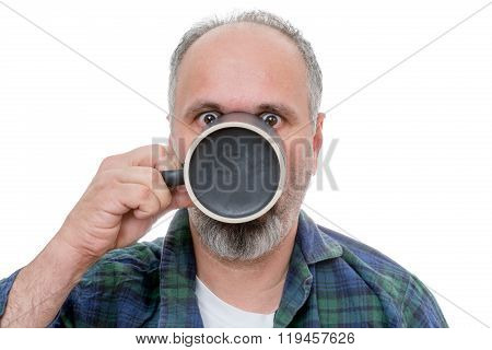 Shocked Man With Cup In Front Of Face