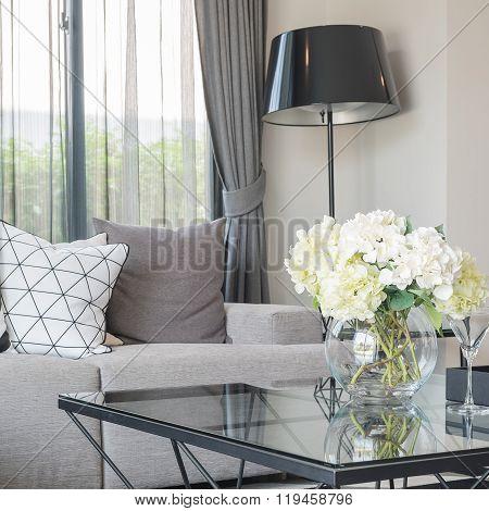 Glass Vase Of Flower On Glss Table In Moder Living Room