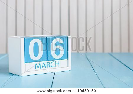 March 6th. Image of march 6 wooden color calendar on white background.  Spring day, empty space for