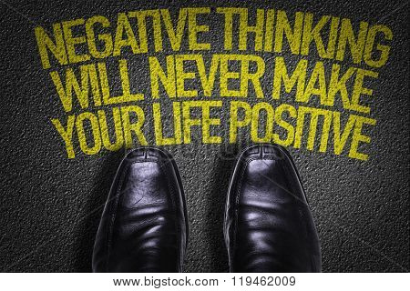 Top View of Business Shoes on the floor with the text: Negative Thinking Will Never Make Your Life Positive