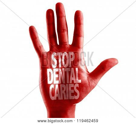 Stop Dental Caries written on hand isolated on white background