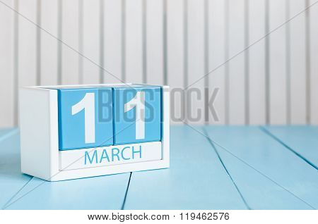 March 11th. Image of march 11 wooden color calendar on white background.  Spring day, empty space fo