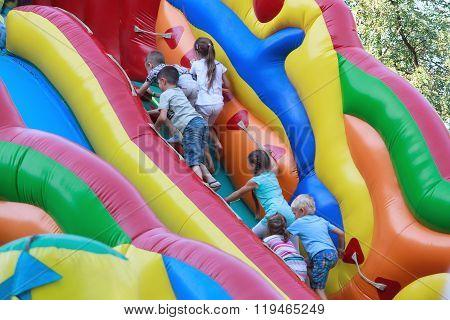 Kiev, Ukraine - August 30, 2015: Children Climbing On The Inflatable Slides mounted on Khreshchatyk