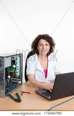 Woman Fixing A Computer Hard Drive At Work