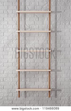 Rope Ladder In Front Of Brick Wall
