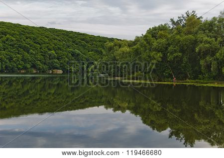 Reflection of two coast in the river the Southern Bug. Ukraine