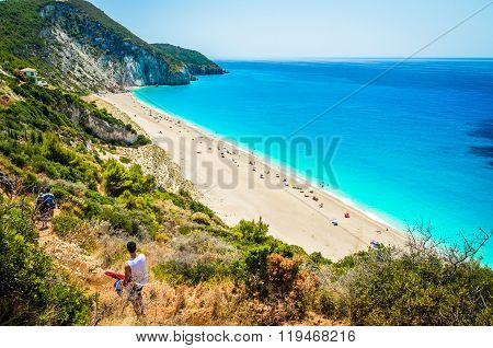 MILOS BEACH, LEFKADA ISLAND, GREECE - JULY 15 2015: People relaxing at the beach. Milos beach is one of the most famous beach in Greece.