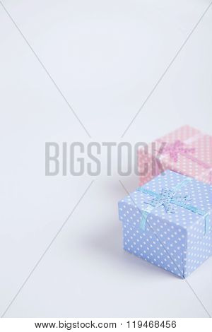 Blue And Pink Spotted Squared Gift Boxes On Light Background