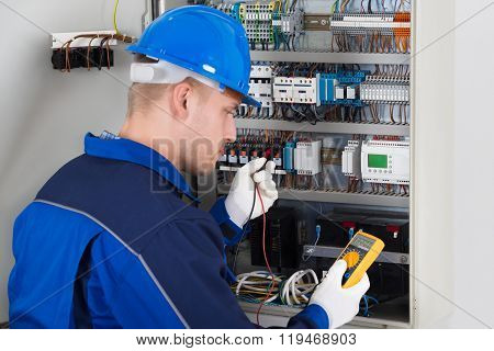 Male Technician Examining Fusebox