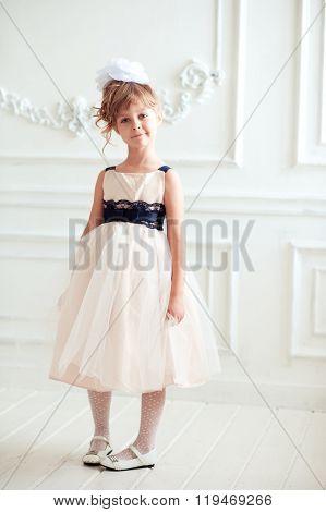 Cute kid girl in white room