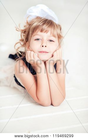 Cute kid girl lying on floor