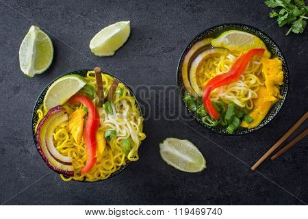 Fresh Thai noodles and curry on slate