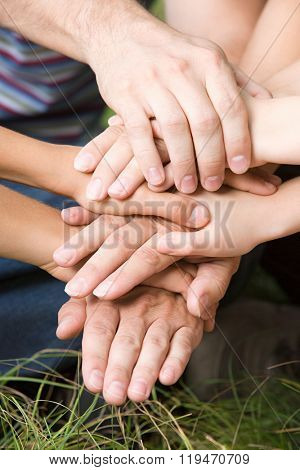 Family putting their hands together