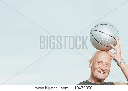 Man putting basketball on his head