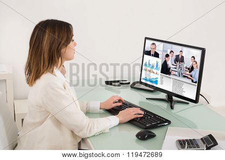 Businesswoman Video Conferencing On Computer