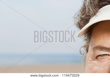 Close up of woman wearing a sun visor