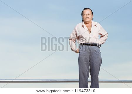Man with hands on hips