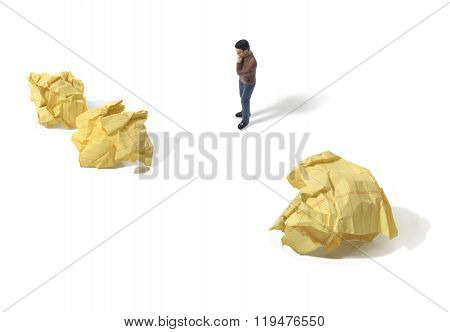 Person Looking At Crumpled Yellow Paper