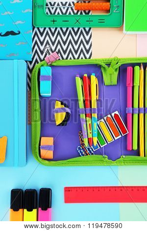 Pencil case with various stationery, close up