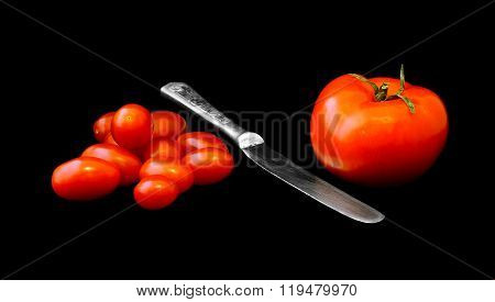 Big Tomato, Heap Of Small Tomatoes And Knife Between Them.