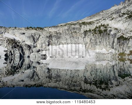 Granite Mountains Reflected In Still Lake
