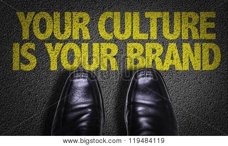 Top View of Business Shoes on the floor with the text: Your Culture Is Your Brand
