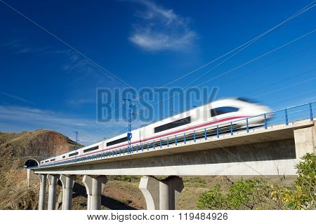 view of a high-speed train crossing a viaduct in Purroy, Zaragoza, Aragon, Spain.