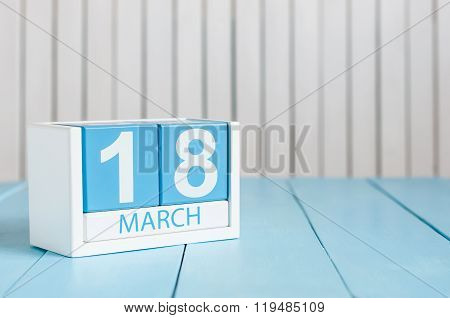March 18th. Image of march 18 wooden color calendar on white background. Spring day, empty space for