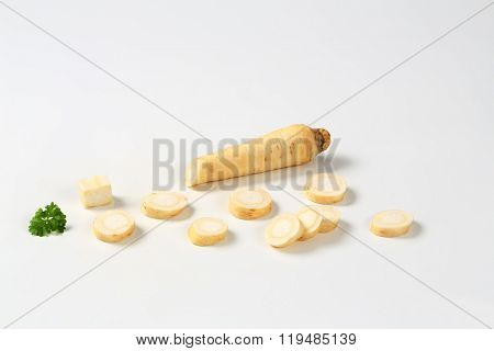sliced root parsley on white background