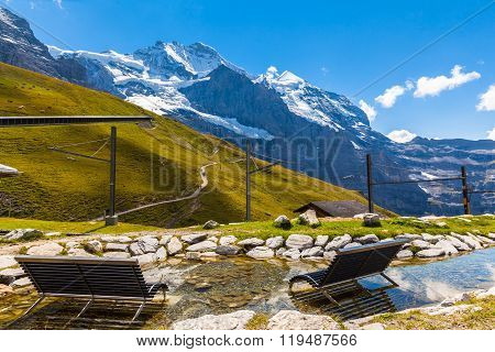 Chairs In Water Facing The Jungfrau