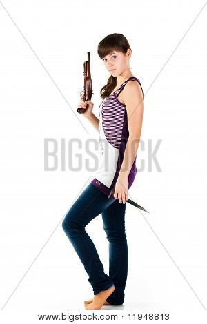 Beautiful Girl With A Gun And Knife Posing