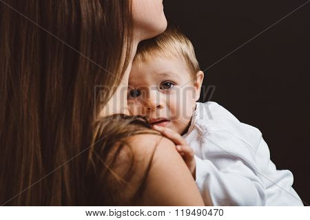Portrait of beautiful mom with frightened