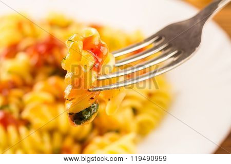 Italian Pasta Fusilli With Tomato Sauce, Skewered On Fork In Plate, Close-up, Selective Focus