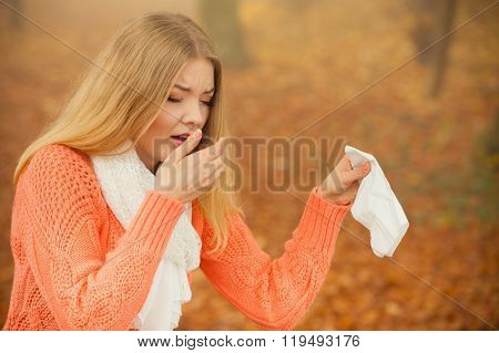 Sick Ill Woman In Autumn Park Sneezing In Tissue.
