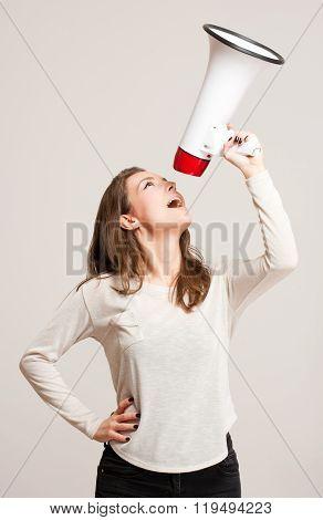 Young Woman Using Loudspeaker.