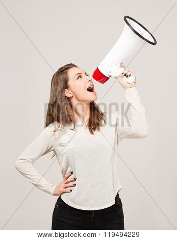 Young Brunette Holding Megaphone.