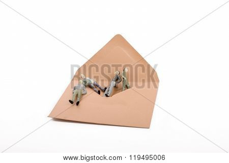 Figurine Men Out Of An Envelope