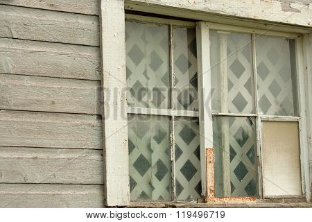 Broken Window and Panes on Old Abandoned Barn