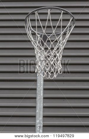 Closeup Basketball Hoop In The Gym With Corrugated Metal Wall Background.
