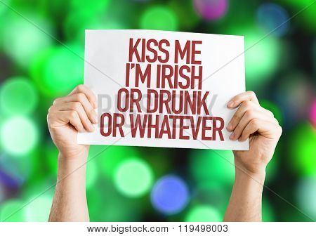 Kiss Me Im Irish Or Drunk Or Whatever placard on bokeh background