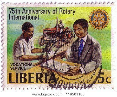 Liberia - Circa 1979: Stamp Printed By Liberia, Shows Rotary Emblem And Vocational Services, Circa 1
