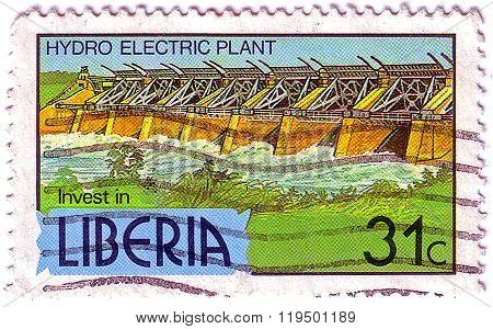 Liberia - Circa 1981: A 31-cent Stamp Printed In Liberia Shows A Hydro Electric Plant To Encourage I