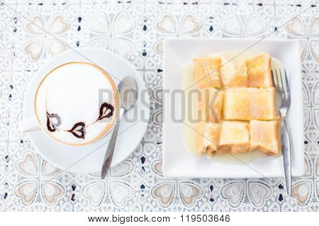 Hot Coffee Mocha Latte In White Mug And Bread On Wood Background At Coffee Cafe.