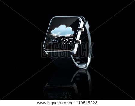 modern technology, object, application, weather and forecast concept - close up of black smart watch with cloud icon and air temperature over black background