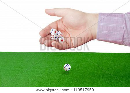Traditional Dice In Male Hand Over Table With Green Cloth