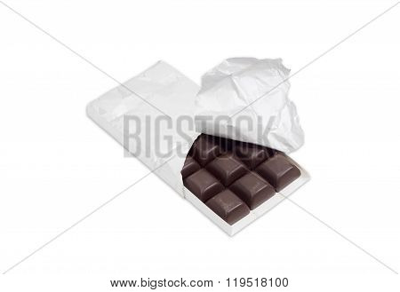 Dark Chocolate In The Opened Packing On A Light Background