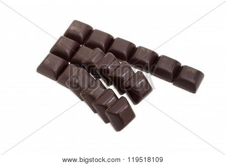 Slices Of Dark Chocolate On A Light Background